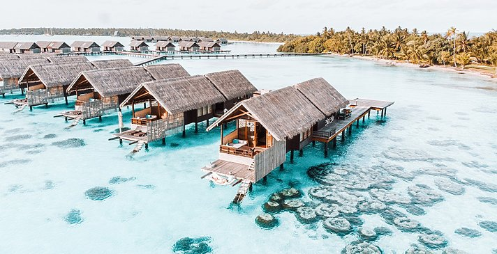 Sunset Over Water Villas - Shangri-La`s Villingili Resort and Spa